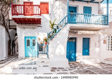 Mykonos, Greece - 01 22 2019 – Typical Greek architecture in the white, cobbled alleys of Mykonos town, houses in the old town of Chora with colorful balconies and white churches, Cyclades, Greece