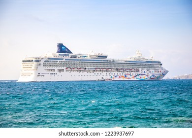 Mykonos, Greece - 17.10.2018: Norwegian Star is a cruise ship owned and operated by Norwegian Cruise Line shipyard in Mykonos in Greece