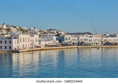 Mykonos, Greece - 25 06 2015 – Typical Greek architecture in the white, cobbled alleys of Mykonos town, houses in the old town with colorful balconies, ports, tourists of Cyclades, Greece