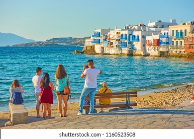 Mykonos, Greece - April 22, 2018: Tourists taking photos of Little Venice district in Mykonos town