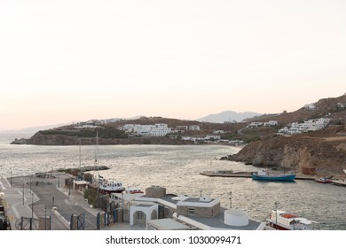 MYKONOS ,GREECE - AUGUST 24, 2017: Sunset View of Mykonos Main Ship Port.  Mykonos is a very touristic Greek island.  It belongs to Cyclades. It is in the north of Cyclades, near Syros and Tinos.