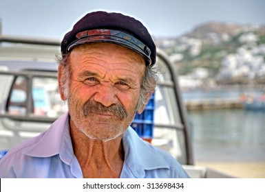 MYKONOS - GREECE ; Greek man is posing on the Island of Mykonos on 14 june 2015.The people in Greece are affraid  how the Greek debt crisis has his impact on there lives and work