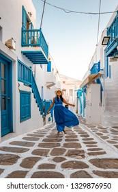 Mykonos Greece Island , young woman in dress on vacation in Mykonos Greece