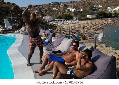 Mykonos, Greece – June 15, 2014 : Gay people have fun on the Super Paradise Club in Mykonos Island.