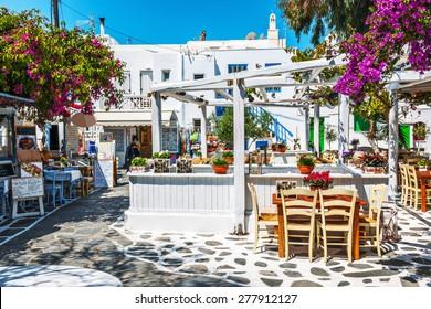 MYKONOS, GREECE - MAY 11: Greek tavern al fresco in Mykonos on May 11, 2014 on Mykonos Island, Greece, Europe