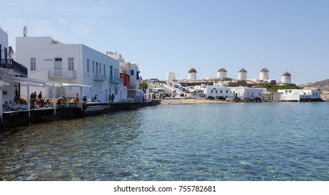 MYKONOS, GREECE - May 19 2016: View of the famous windmills of Mykonos island from Little Venice restaurant