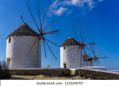 Mykonos, Greece traditional white windmills without crowd. Day view of windmills, the islands landmark, at Aleykantra - Little Venice area.