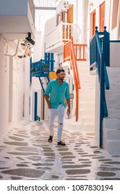Mykonos Greece, Young man on vacation at the romantic colorfull town of Mikonos