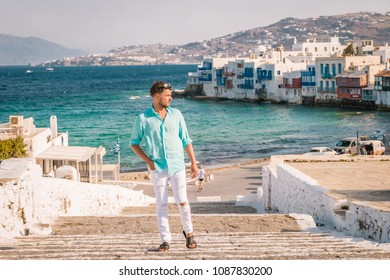 89a5c1997f6 Mykonos Greece, Young man on vacation at the romantic colorfull town of  Mikonos