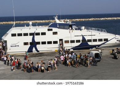 MYKONOS, GREECE-SEP. 6, 2019:  People line up for the  Jet boat ferry service heading from Mykonos to Santorini, a quick and pleasant mode of transportation.