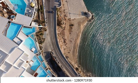 Mykonos island, Cyclades / Greece - July 15 2018: Aerial drone photo of Cavo Tagoo luxury resort famous for number of pools in new public port of Mykonos island, Cyclades, Greece