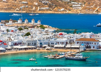 Mykonos port with boats and windmills in the morning, Cyclades islands, Greece