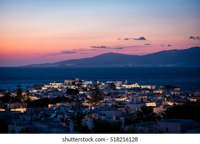 Mykonos town after sunset with buildings illuminated by street lights