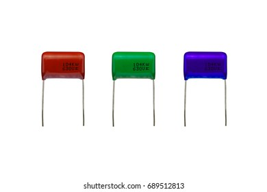 Mylar polyester capacitors with a brown and a green and a blue color isolated on white background. electronics part concept.