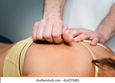 Myofascial Release - practitioner working on patient's back