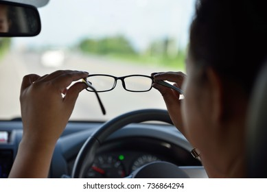 Myopia (nearsightedness), Short sighted woman holding eyeglasses for good vision before driving, Safety on the road, selective focus