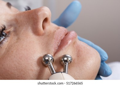Myostimulation cosmetic procedures. Train muscles of the face using an electric current. Hardware cosmetology. Equipment.