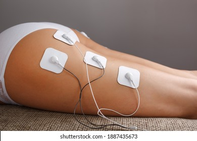 Myostimulation procedure on the legs Buttocks in a beauty salon. The concept of cosmetology, massage and overweight