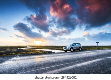MYRDASSANDUR, ICELAND - FEBRUARY 4, 2014: Tourists parked their rental car on the side of the road in the volcanic landscape of Myrdalssandur in the southern part of Iceland, on February 4, 2014