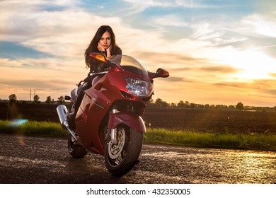 MYRHOROD, UKRAINE - MAY 04, 2016: young girl racer before the start of racing in the Street. Honda motorcycles are very popular among young people in Ukraine.