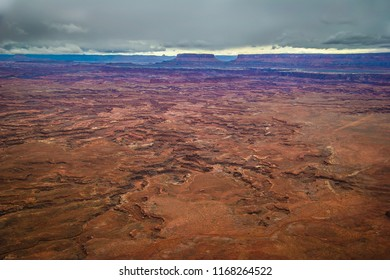 A myriad of canyons and old remote roads are seen from this view of the Needles Overlook near Monticello, Utah. Prominent land formations are seen in the distance.