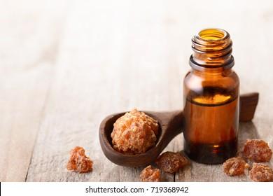 myrrh essential oil on the wooden board
