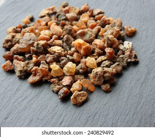 Myrrh incense tears (myrrhae gummi from kenia) in tears on a grey slate stone background