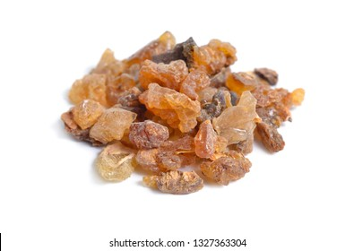 Myrrh is a natural gum or resin extracted from a number of small, thorny tree species of the genus Commiphora Isolated on white,