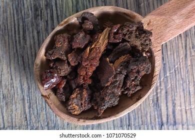 myrrh tree resin closeup in wooden spoon