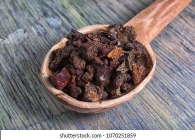 myrrh tree resin in wooden spoon