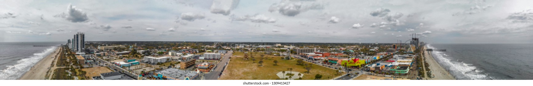 MYRTLE BEACH, SC - APRIL 2018: Panoramic aerial skyline and coastline on a cloudy afternoon. This is a famous tourist destination in summer.