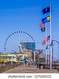 Myrtle Beach, SC / USA - 9-12-2017 Daytime at the Myrtle Beach boardwalk with the ferris wheel