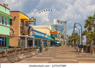 Myrtle Beach, SC / USA - 9-19-2018 Deserted Myrtle Beach Boardwalk with missing ferris wheel carts after Hurricane Florence.