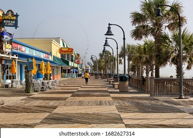 MYRTLE BEACH, SOUTH CAROLINA - MARCH 19, 2020: The Boardwalk at Myrtle Beach, SC, March 19 the restaurants are closed or serving take out only as people social distance 6 feet amid Covid-19 epidemic.
