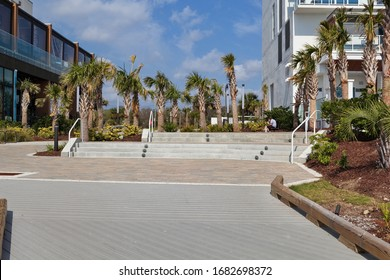 MYRTLE BEACH, SOUTH CAROLINA - MARCH 19, 2020: A Boardwalk entrance at Myrtle Beach, SC, March 19, 2020 spring break as restaurants are closed or serving take out only and people warned to distance.