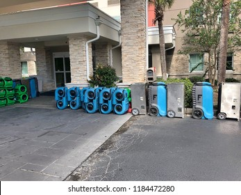 Myrtle Beach, South Carolina / USA - September 18 2018: Stacks of industrial drying fans are lined up outside of a resort in Myrtle Beach for drying flood damage in a resort due to Hurricane Florence.