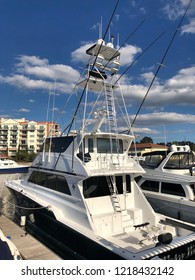"Myrtle Beach, South Carolina / USA - October 25 2018: A large off-shore, deep sea fishing boat called ""Take Time"" is docked at Grande Dunes Marina located in Myrtle Beach South Carolina."