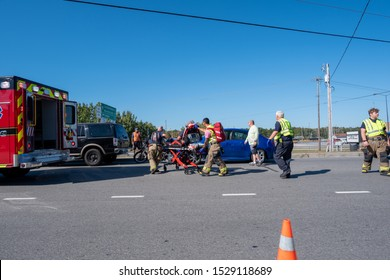 Myrtle Beach, South Carolina / USA - October 12, 2019: First responders on the scene of a vehicle accident sending at least one person to the hospital by ambulance. Hwy 707 Socastee High School.