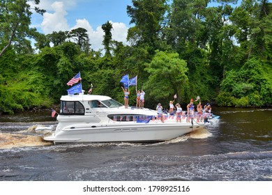 Myrtle Beach, South Carolina / USA July 26 2020: More than 1000 boats decorated in an abundance of red, white and blue supporting Donald Trump 2020 with a boat parade on the intracoastal waterway.