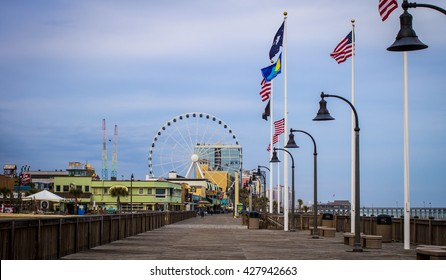 Myrtle Beach, South Carolina, USA - February 9, 2015: Panorama of the downtown Myrtle Beach Boardwalk area. Myrtle Beach is a popular resort town on America's eastern seaboard.