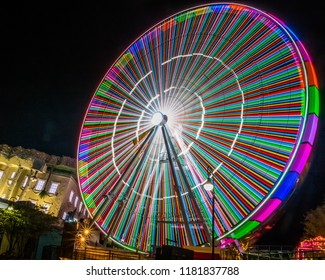 Myrtle Beach, South Carolina/USA - September 6 2018 : Myrtle Beach Ferris Wheel bursting with a rainbow of colors