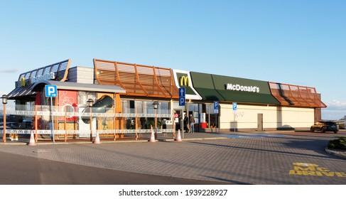 MYSLIBORZ, POLAND - March 17, 2021: McDonald restaurant near the express road S3 on evening. Empty restaurant because of Covid-19