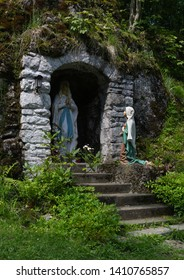 Myslik lourdes (Myslikovske Lurdy), Czech Republic / Czechia - statue of Virgin Mary and Bernadette. Religious sculpture of Lourdes apparition / Marian apparition.
