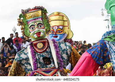 MYSORE, INDIA - OCTOBER 11: Men wearing colourful Ravana mask costume at parade or procession on Dussehra or Dasara festival at Mysore Palace on. October 11, 2016 Karnataka, India.