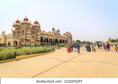 Mysore, Karnataka, India. 04/19/2014. View of Mysore Palace, also known as Ambavilas Palace, and local people walking around.