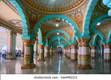 Mysore, Karnataka, India - November 25th 2018 : Beautiful decorated interior ceiling and pillars of the Durbar or audience hall inside the royal Mysore Palace. A very famous tourist attraction.