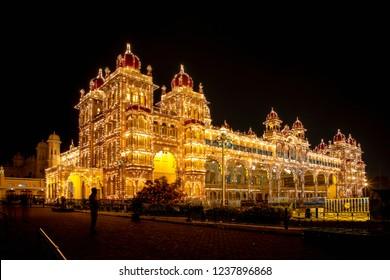 MYSORE, KARNATAKA, INDIA - OCTOBER 21, 2018: Mysuru Dasara festival of lights at the Mysore Palace.  100,000 lights illuminate the palace buildings over a ten day period each year.