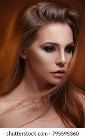Mysterious beauty portrait of a chic woman with long straight hair, mixed light.