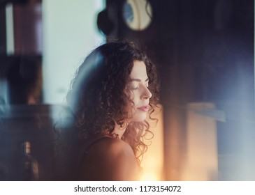 Mysterious and beauty woman dark portrait