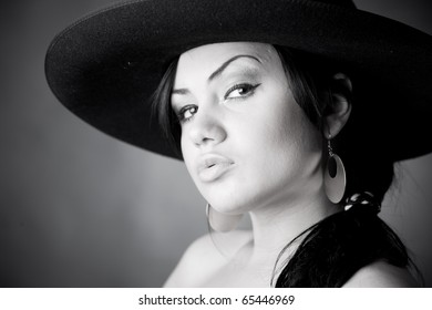 Mysterious brunette in interesting hat;